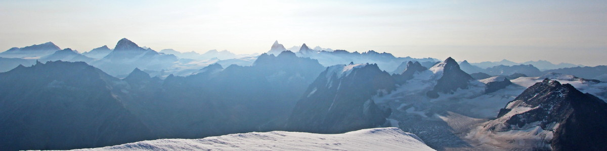 Photo from Pigne d'Arolla summit with the Weisshorn in the north (left) to the Matterhorn then Dent d'Herens in the centre, and Italian hills away to the south