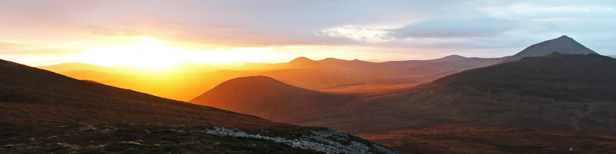 Photo of sunset over the hills around the upper Langwell valley on the southern boundary of Caithness with Sutherland