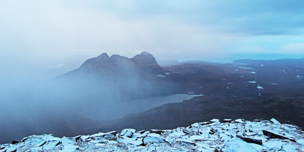 Photo of curtains of snow clearing eastwards from Suilven and Canisp