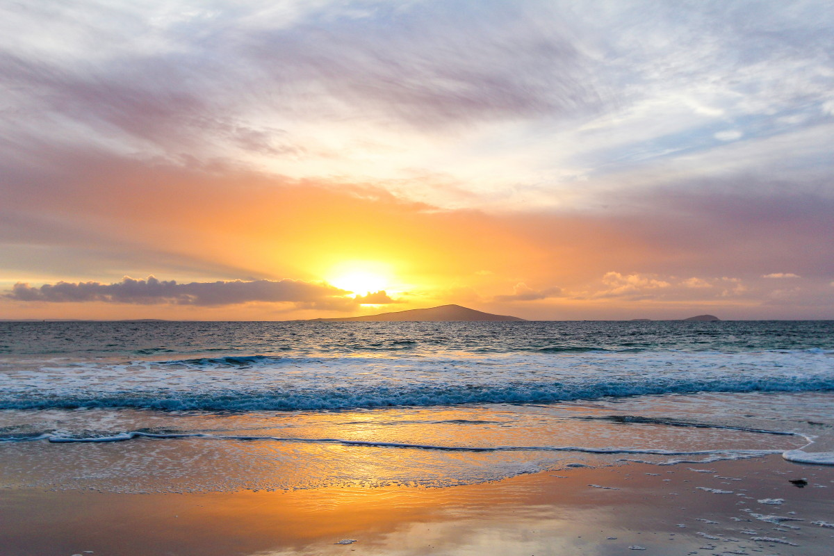 Photo of sunset over Pabaigh (Pabbay) from the lovely beach at Taobh Tuath (Northton)