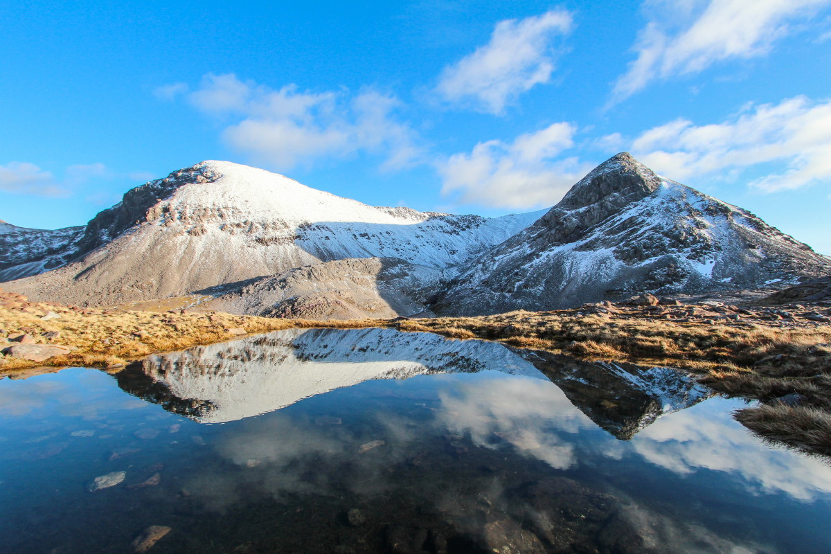 Photo of Sgurr Ban and Spidean Coire nan Clach of Beinn Eighe reflected in pools on the bealach between Ruadh-stac Beag and the north ridge of Spidean Coire nan Clach