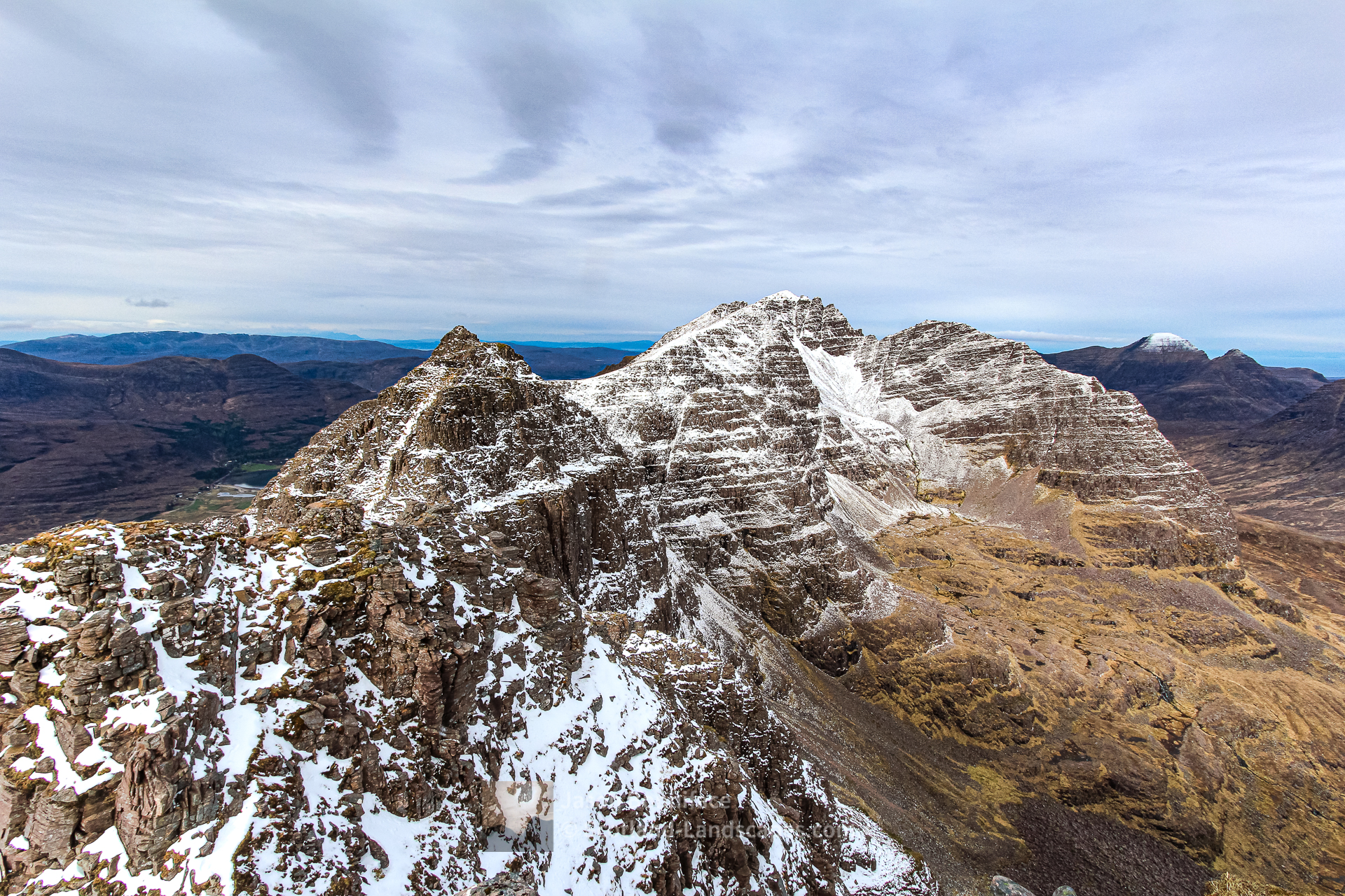 Photo of spring snow on the Am Fasarinen pinnacles and second Munro of Liathach, Mullach an Rathain