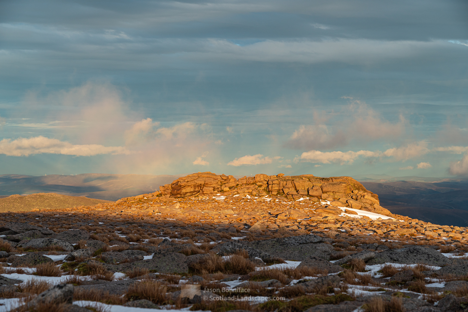 Photo of late sunlight shines on the granite tor just east of the summit of Cairngorm