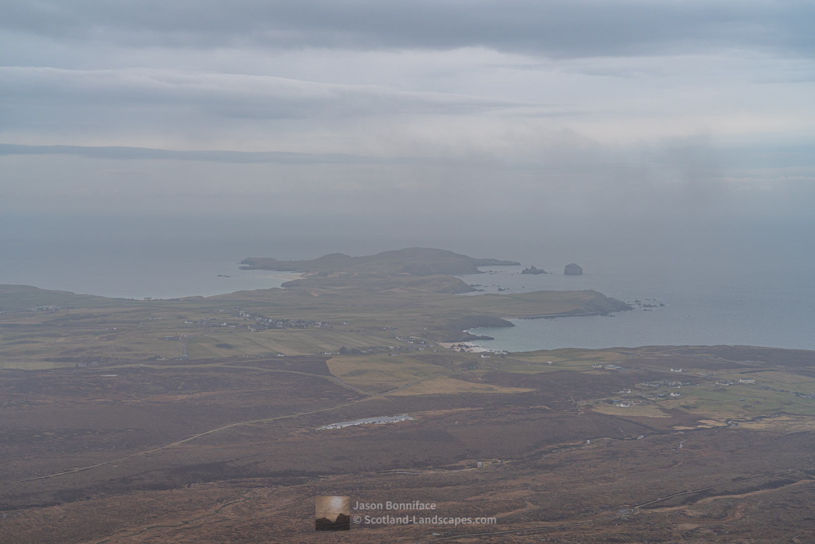 A view through mist to Durness and the headland of An Fharaid (Faraid Head) from the summit of Beinn Ceannabeinne