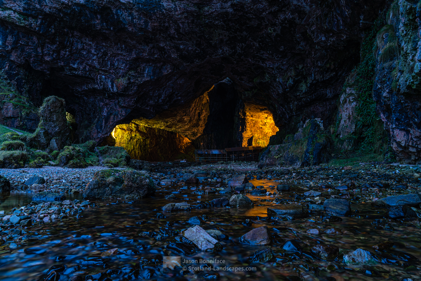A long exposure view into Smoo Cave at Dusk with very little water flowing. The waterfall in the cave was dry