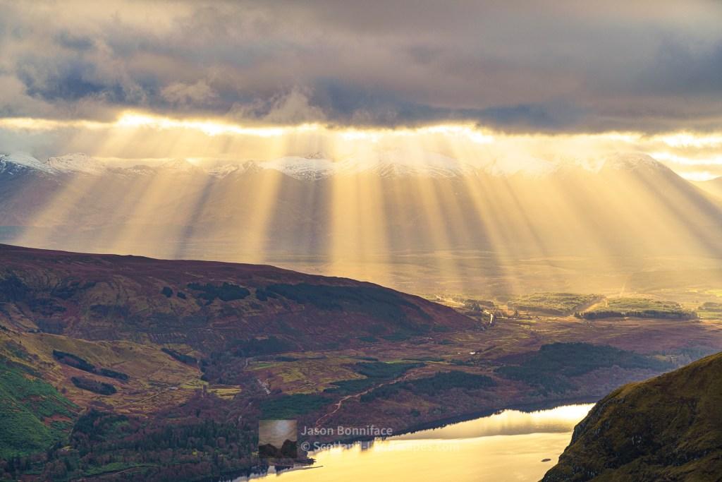 Crepuscular Rays over Spean Bridge and the Nevis Range, Lochaber